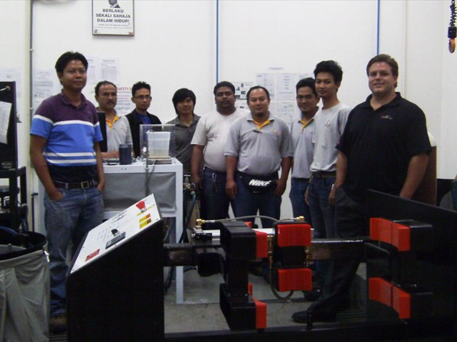 Galiso's Rick Wright with the crew at Destini Berhad, Malaysia