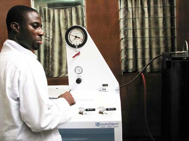 Jeffrey operates the Galiso Proof Pressure Tester, Accra, Ghana - Standards Board