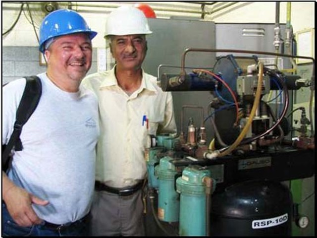 Ray with Asghar on an install, Abdullah Hashim, Saudi Arabia